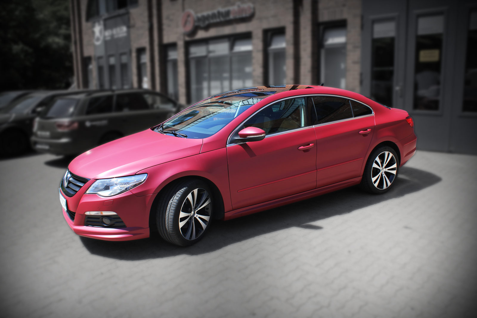VW Passat CC Folierung in cherry red metallic matt.