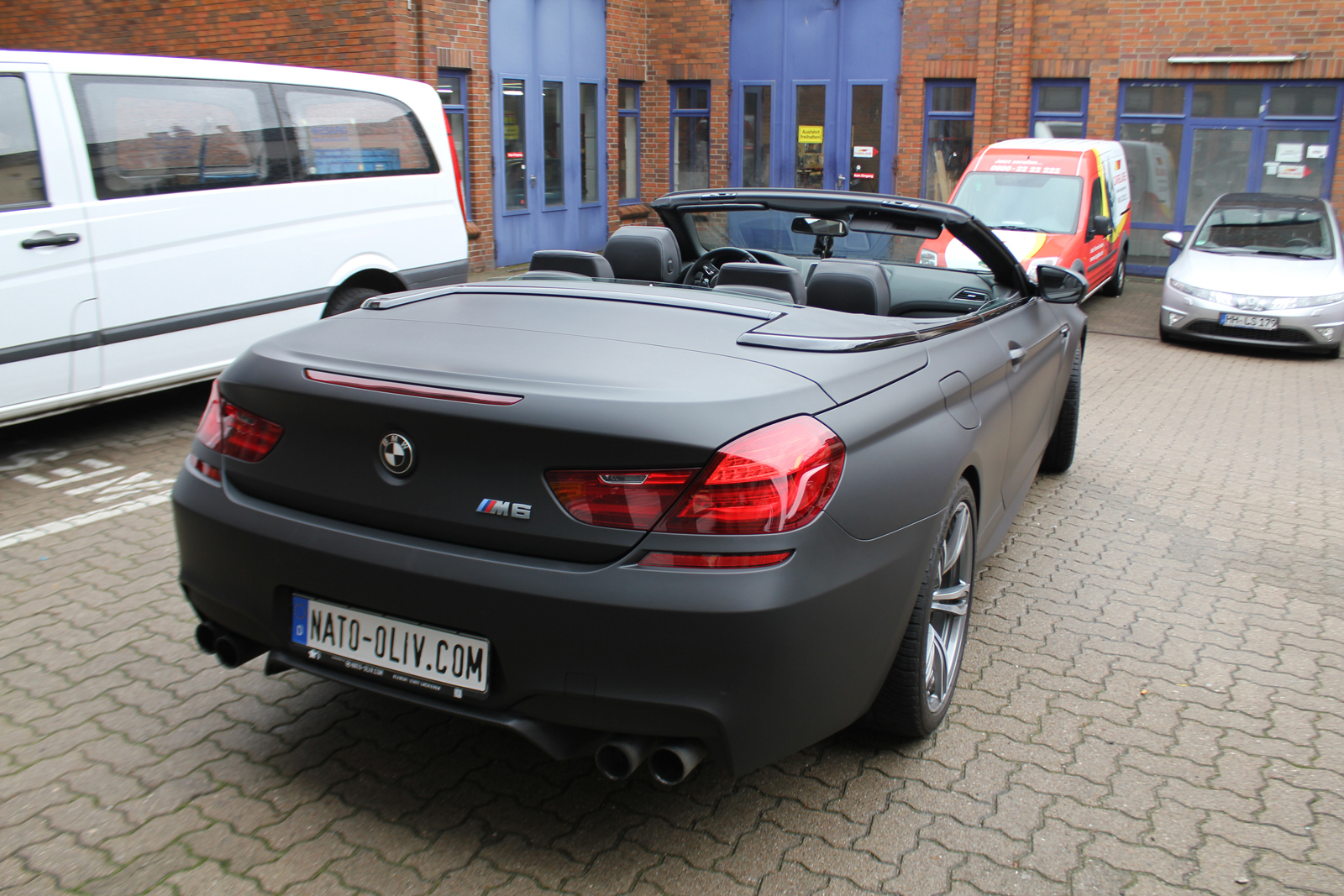 Auto Folierung Car Wrapping BMW M6 Cabriolet Schwarz Matt Carbon