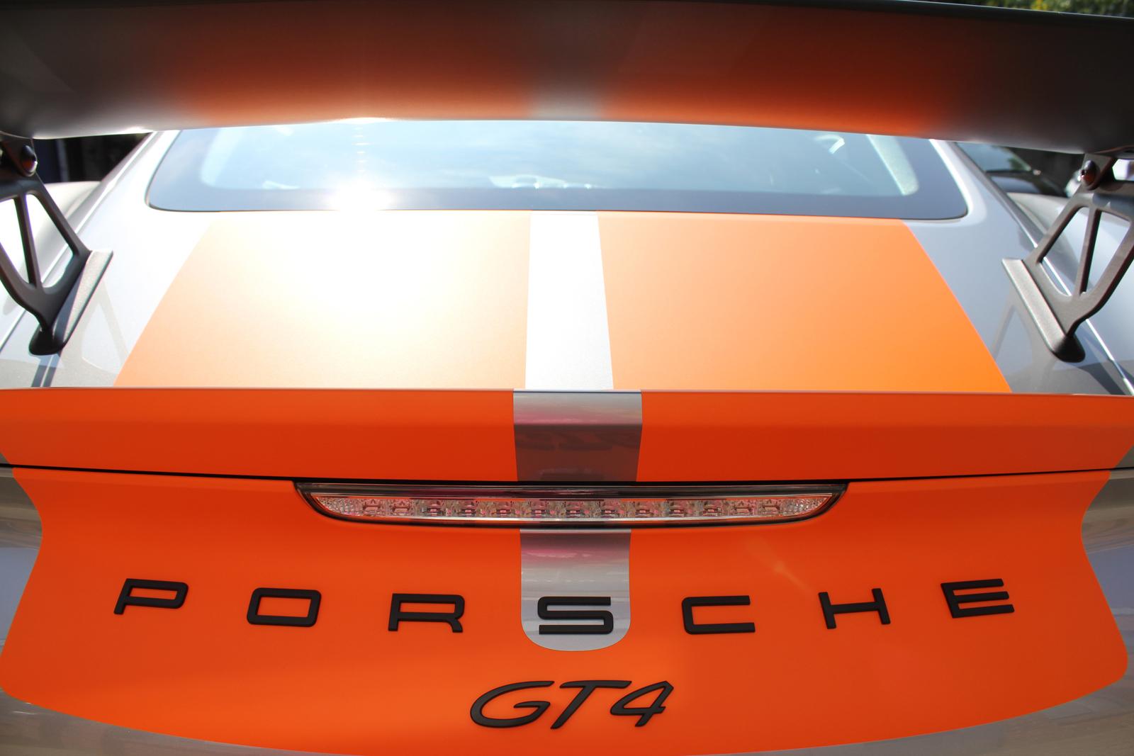 porsche_cayman_gt4_rallyestreifen_orange_05
