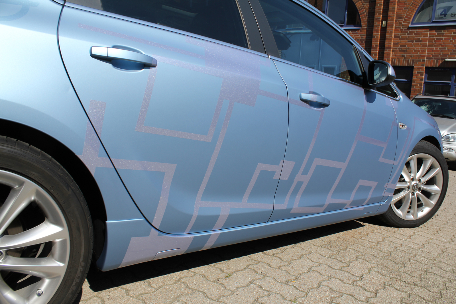 Car Wrapping Auto Folierung Opel Astra Frost Blue Matt Metallic